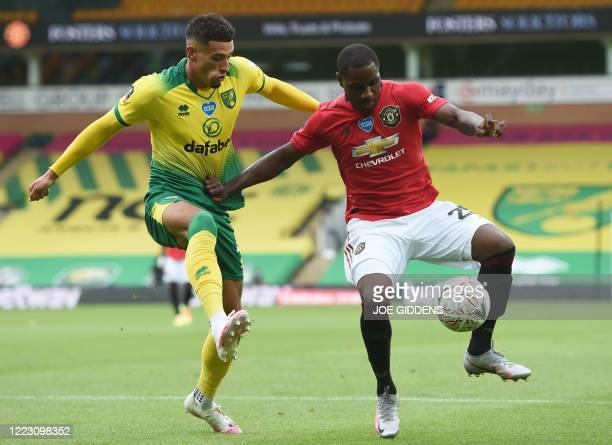 Norwich City's English midfielder Ben Godfrey closes in on Manchester United's Nigerian striker Odion Ighalo during the English FA Cup quarter-final...