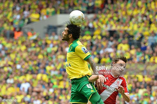 Norwich City's English midfielder Bradley Johnson rises above Middlesbrough's English midfielder Dean Whitehead during the English Championship play...