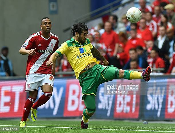 Norwich City's English midfielder Bradley Johnson stretches for the ball during the English Championship play off final football match between...