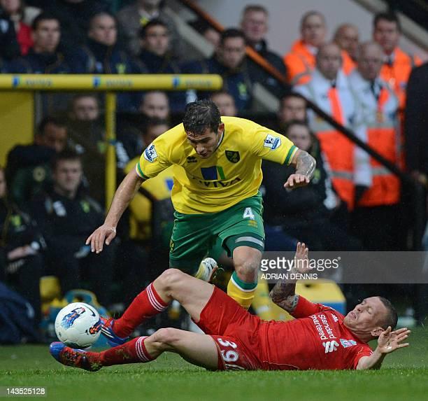 Norwich City's English midfielder Bradley Johnson vies with Liverpool's Welsh striker Craig Bellamy during the English Premier League football match...