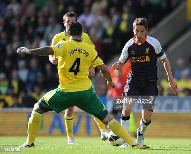 Norwich City's English midfielder Bradley Johnson vies with Liverpool's Welsh midfielder Joe Allen during the English Premier League football match...