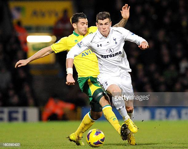 Norwich City's English midfielder Bradley Johnson vies with Tottenham Hotspur's Welsh midfielder Gareth Bale during their English Premier League...