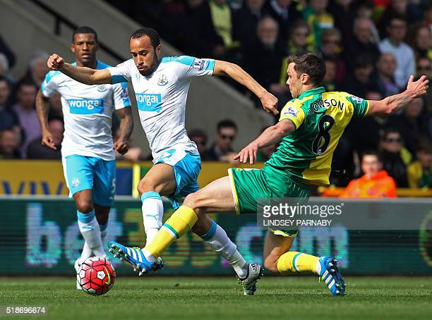 Norwich Citys English midfielder Jonny Howson vies with Newcastle United's English midfielder Andros Townsend during the English Premier League...