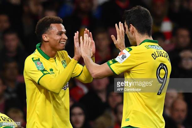 Norwich City's English midfielder Josh Murphy celebrates scoring the opening goal during the English League Cup fourth round football match between...