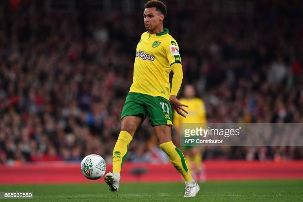 Norwich City's English midfielder Josh Murphy scores the opening goal during the English League Cup fourth round football match between Arsenal and...