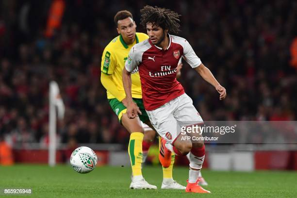 Norwich City's English midfielder Josh Murphy vies with Arsenal's Egyptian midfielder Mohamed Elneny during the English League Cup fourth round...