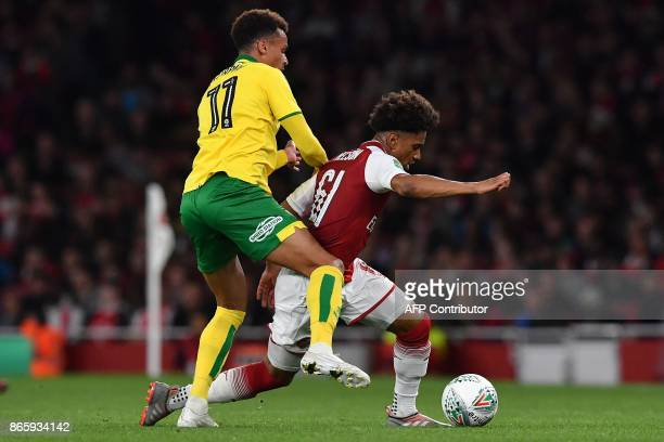 Norwich City's English midfielder Josh Murphy vies with Arsenal's English midfielder Reiss Nelson during the English League Cup fourth round football...