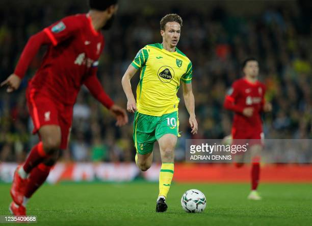 Norwich City's English midfielder Kieran Dowell runs with the ball during the English League Cup third round football match between Norwich City and...