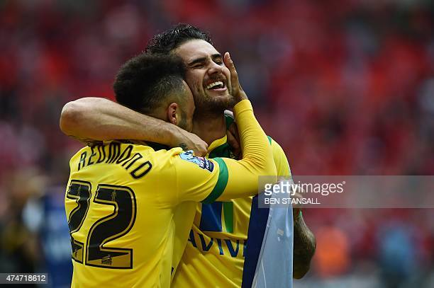 Norwich City's English midfielder Nathan Redmond celebrates with Norwich City's English midfielder Bradley Johnson after the final whistle of the...