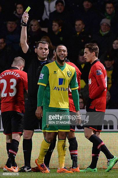Norwich City's English midfielder Nathan Redmond is given a yellow card by referee Phil Dowd during the English Premier League football match between...
