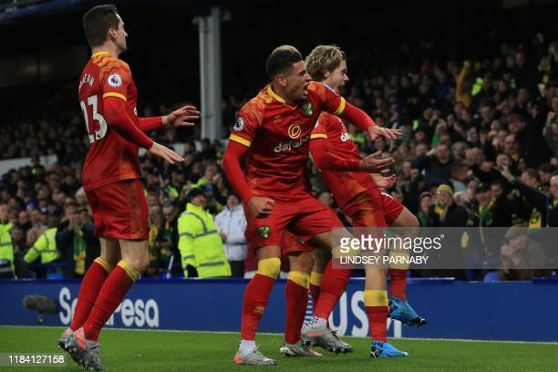 Norwich City's English midfielder Todd Cantwell celebrates with teammates after scoring his team's first goal during the English Premier League...