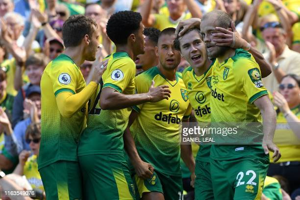 Norwich City's English midfielder Todd Cantwell celebrates with Norwich City's Finnish striker Teemu Pukki and teammates after scoring their opening...