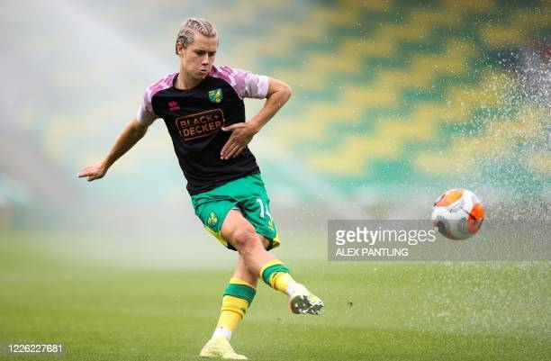 Norwich City's English midfielder Todd Cantwell controls the ball as he warms up prior to the English Premier League football match between Norwich...
