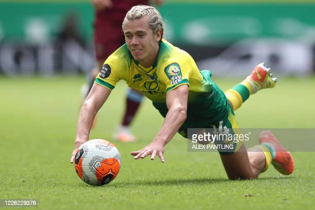 Norwich City's English midfielder Todd Cantwell falls on the pitch after a tackle during the English Premier League football match between Norwich...