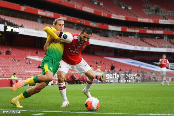 Norwich City's English midfielder Todd Cantwell fights for the ball with Arsenal's Germanborn Bosnian defender Sead Kolasinac during the English...