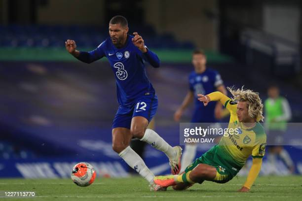 Norwich City's English midfielder Todd Cantwell fouls Chelsea's English midfielder Ruben LoftusCheek during the English Premier League football match...