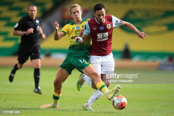 Norwich City's English midfielder Todd Cantwell vies with Burnley's English midfielder Dwight McNeil during the English Premier League football match...