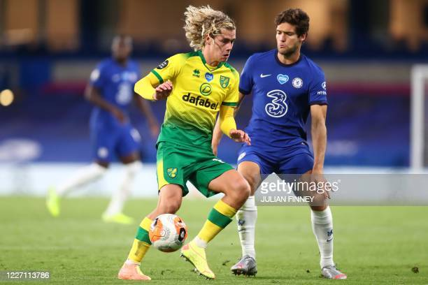 Norwich City's English midfielder Todd Cantwell vies with Chelsea's Spanish defender Marcos Alonso during the English Premier League football match...
