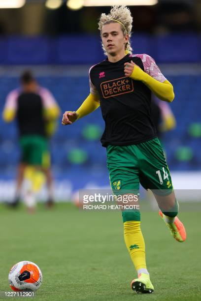 Norwich City's English midfielder Todd Cantwell warms up before the English Premier League football match between Chelsea and Norwich City at...
