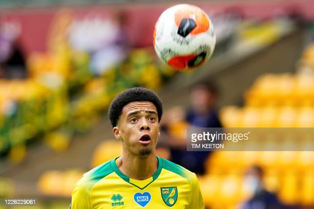 Norwich City's English-born Northern Irish defender Jamal Lewis eyes the ball during the English Premier League football match between Norwich City...
