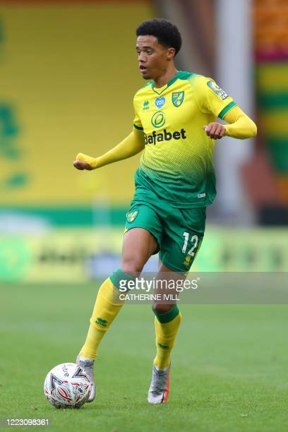 Norwich City's English-born Northern Irish defender Jamal Lewis runs with the ball during the English FA Cup quarter-final football match between...