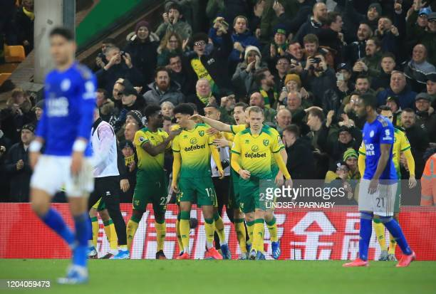 Norwich City's English-born Northern Irish defender Jamal Lewis celebrates scoring the opening goal with his teammates during the English Premier...