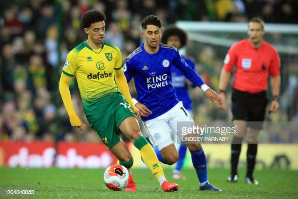 Norwich City's English-born Northern Irish defender Jamal Lewis vies for the ball against Leicester City's Spanish striker Ayoze Perez during the...