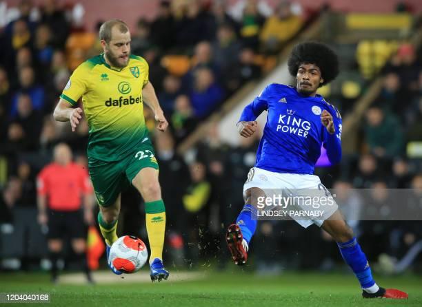 Norwich City's Finnish striker Teemu Pukki vies for the ball against Leicester City's English midfielder Hamza Choudhury during the English Premier...