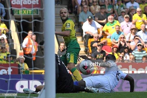 Norwich City's Finnish striker Teemu Pukki watches his shot beat Chelsea's Spanish goalkeeper Kepa Arrizabalaga for their second goal during the...
