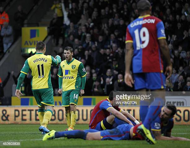 Norwich City's Gary Hooper celebrates scoring a goal during the English Premier League football match between Norwich City and Crystal Palace at...