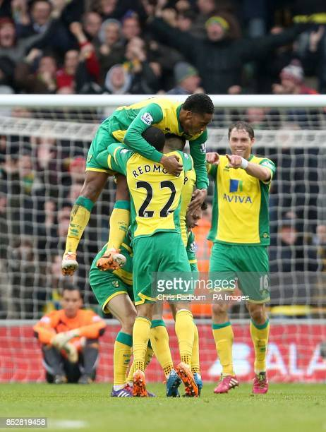 Norwich City's Gary Hooper celebrates scoring their first goal of the game with teammates