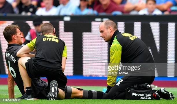 Norwich City's German defender Christoph Zimmermann gets attention on the field for an injury during the English Premier League football match...
