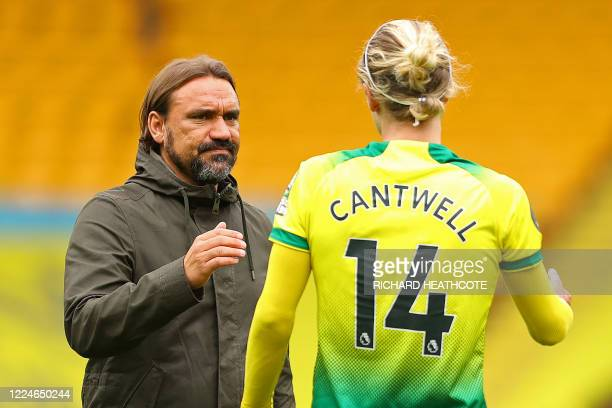 Norwich City's German head coach Daniel Farke commiserates Norwich City's English midfielder Todd Cantwell after the English Premier League football...