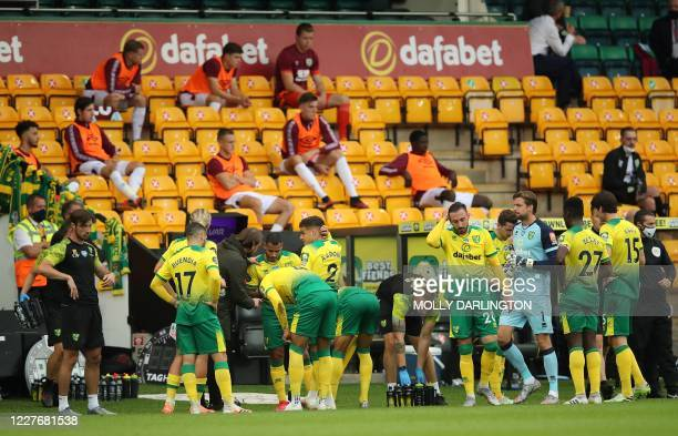 Norwich City's German head coach Daniel Farke talks with his players during a drinks break in the first half of the English Premier League football...