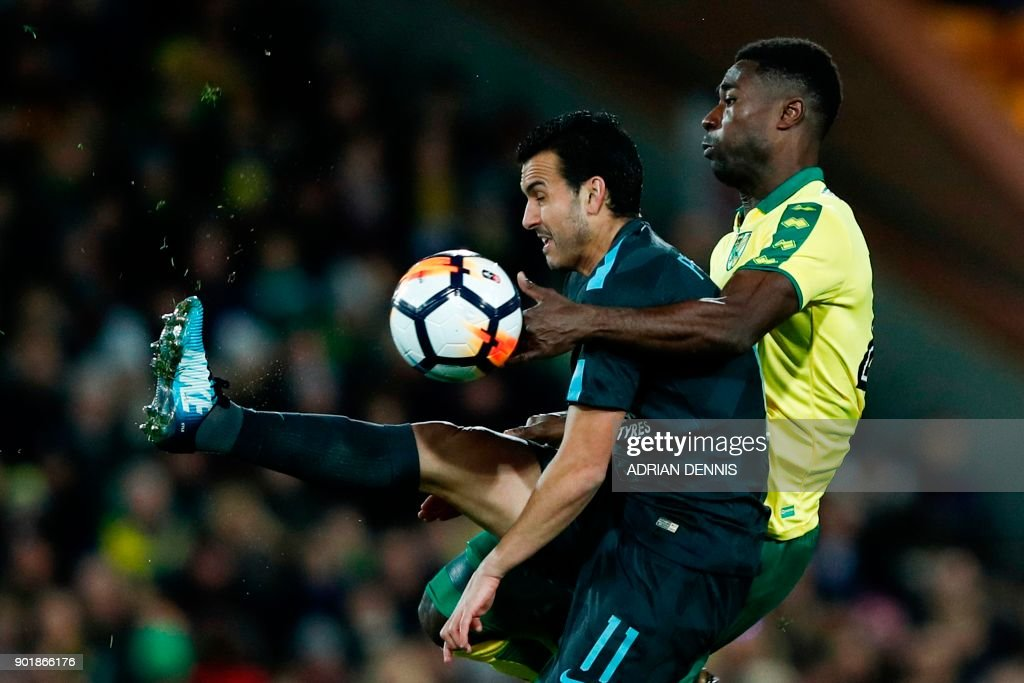 TOPSHOT - Norwich City's Ghanaian-born Norwegian midfielder Alexander Tettey (R) pressures Chelsea's Spanish midfielder Pedro (L) during the English FA Cup third round football match between Norwich City and Chelsea at Carrow Road in Norwich, north east England on January 6, 2018. / AFP PHOTO / Adrian DENNIS / RESTRICTED TO EDITORIAL USE. No use with unauthorized audio, video, data, fixture lists, club/league logos or 'live' services. Online in-match use limited to 75 images, no video emulation. No use in betting, games or single club/league/player publications. /