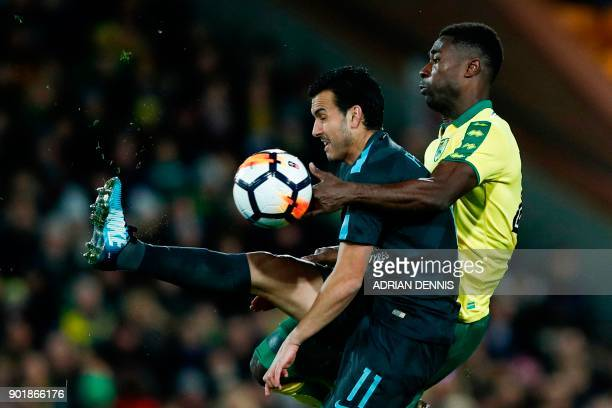 TOPSHOT Norwich City's Ghanaianborn Norwegian midfielder Alexander Tettey pressures Chelsea's Spanish midfielder Pedro during the English FA Cup...