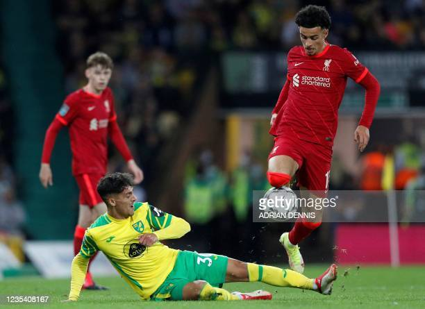 Norwich City's Greek defender Dimitris Giannoulis vies with Liverpool's English midfielder Curtis Jones during the English League Cup third round...