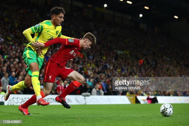 Norwich City's Greek defender Dimitris Giannoulis vies with Liverpool's Northern Irish defender Conor Bradleyduring the English League Cup third...