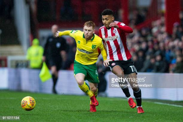Norwich City's Harrison Reed vies for possession with Brentford's Ollie Watkins during the Sky Bet Championship match between Brentford and Norwich...