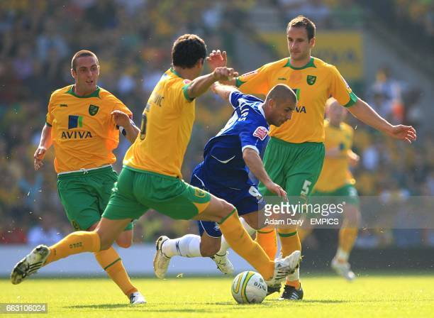 Norwich City's John Kennedy and Dejan Stefanovic body check Birmingham City's Kevin Phillips in a battle for the ball