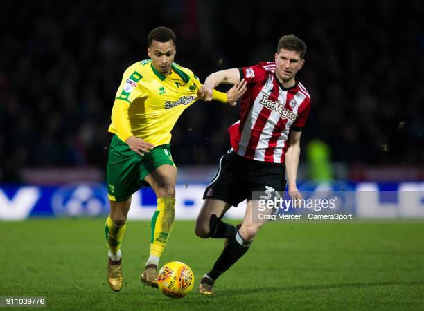Norwich City's Josh Murphy battles for possession with Brentford's Chris Mepham during the Sky Bet Championship match between Brentford and Norwich...