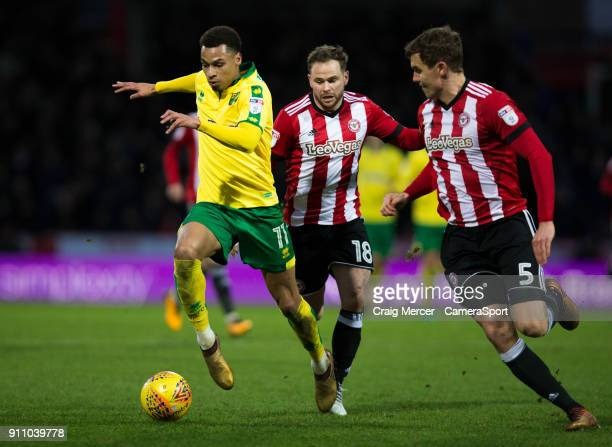Norwich City's Josh Murphy holds off the challenge from Brentford's Alan Judge and Brentford's Andreas Bjelland during the Sky Bet Championship match...