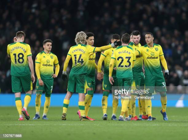 Norwich City's Kenny McLean is consoled after missing his penalty during the penalty shootout during the FA Cup Fifth Round match between Tottenham...
