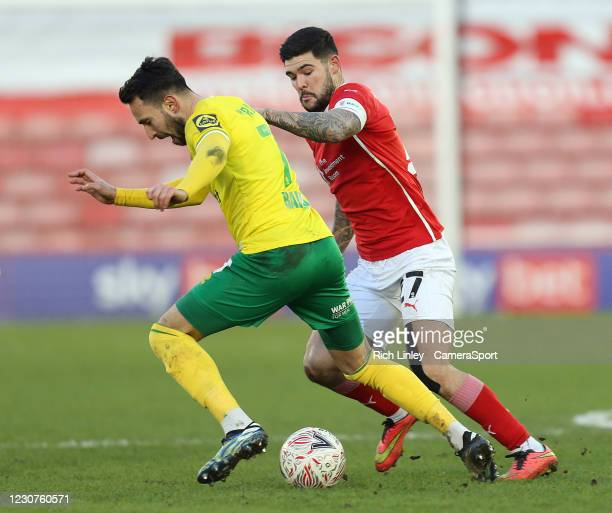 Norwich City's Lukas Rupp under pressure from Barnsley's Alex Mowatt during the The Emirates FA Cup Fourth Round match between Barnsley and Norwich...