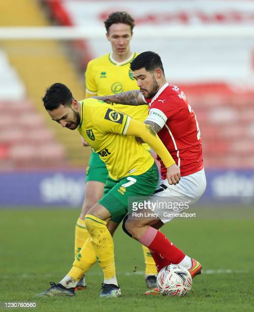 Norwich City's Lukas Rupp vies for possession with Barnsley's Alex Mowatt during the The Emirates FA Cup Fourth Round match between Barnsley and...
