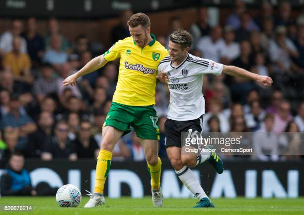 Norwich City's Marley Watkins vies for possession with Fulham's Oliver Norwood during the Sky Bet Championship match between Fulham and Norwich City...