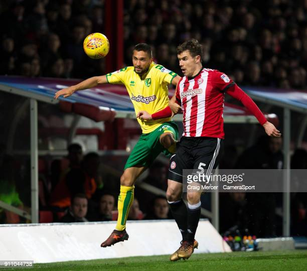Norwich City's Moritz Leitner vies for possession with Brentford's Andreas Bjelland during the Sky Bet Championship match between Brentford and...