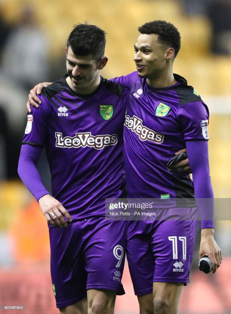 Norwich City's Nelson Oliveira (left) gets a hug from Josh Murphy at the end of the Sky Bet Championship match at Molineux, Wolverhampton.