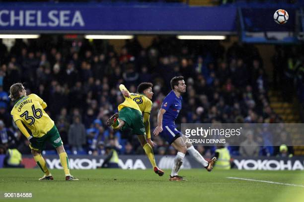 Norwich City's Northern Irish defender Jamal Lewis scores his team's first goal during the FA Cup third round replay football match between Chelsea...