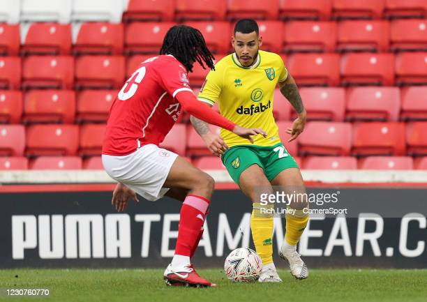 Norwich City's Onel Hernandez under pressure from Barnsley's Toby Sibbick during the The Emirates FA Cup Fourth Round match between Barnsley and...